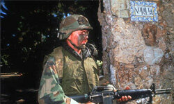 A U.S. soldier stands guard near the Noriega residence on Dec. 28, 1989, in Panama City, Panama, after American troops invaded Gen. Manuel Noriega's residence.