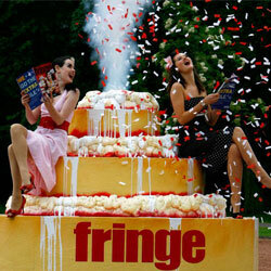Confetti erupts from a giant cake at the 2007 Edinburgh Fringe Festival.