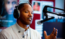 Actor/singer Jamie Foxx visits a Philadelphia radio station owned by Clear Channel in Dec. 2010. Thanks to deregulation, Clear Channel owns more than 850 radio stations in 150 U.S. markets. See corporation pictures.