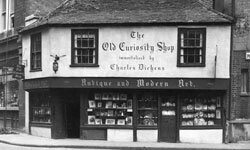 Pictured here is the real Old Curiosity Shop, as immortalized by Dickens, in Portsmouth Street, London.
