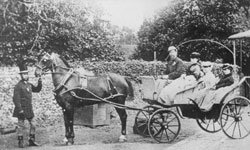 Author Charles Dickens (1812-1870) pictured with his wife, Catherine Dickens (1815-1879), and two of their daughters, seated in a horsedrawn carriage, circa 1850.