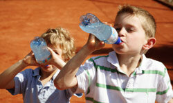Plain bottled water will still keep your kids hydrated without any of the extra, unnecessary ingredients.