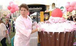 Baker Teri Cahn poses with one of the colossal cupcakes in Boca Raton, Fla.