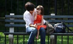 Katie Holmes (with her equally fashionable daughter Suri) wears a flattering pair of dark jeans.