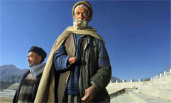 Abdul Jalil (forefront) stands inside Ghazi Stadium on Jan. 26, 2002, in Kabul, Afghanistan. Jalil lost his hand when the Taliban accused him of being a thief and cut it off as punishment.