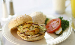 A traditional, grilled chicken breast becomes a unique treat when topped with pineapple.