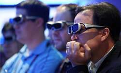 CES attendees wear 3-D glasses as they watch a 3-D television in the Panasonic booth at the 2010 International Consumer Electronics Show at the Las Vegas Hilton January 7, 2010 in Las Vegas.