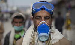 Yemenis protesters strap on respirators and goggles for a 2011 antigovernment protest.