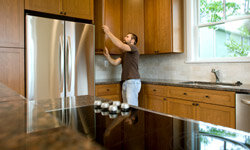 Even if you pay someone to install your cabinets you'll want to be up to date on green construction options.