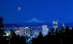 The Portland skyline is backed by Mount Hood.