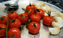 Tomatoes and garlic: the new peanut butter and jelly. See pictures of international tomato dishes.