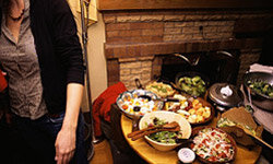 Despite the guest list and volume of food, hosting a potluck is easier than you'd think.