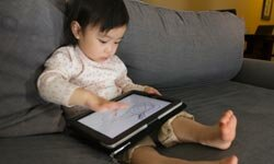 Kids love writing on tablet PCs with their fingers.