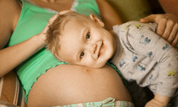 Give positive attention to older children to make the arrival of the new baby easier.