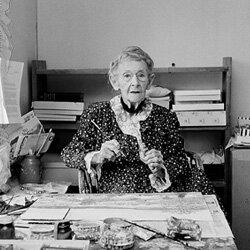 Grandma Moses, hard at work on a painting at age 99.