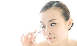 Use an eyelash curler to transform your peepers.