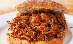 Pulled pork sandwiches are inexpenive to make, thanks to using a cheap cut of pork.