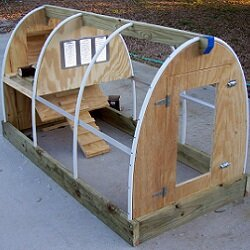 A mobile coop offers more flexibility and allows the chickens to work the land.