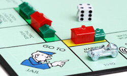 This game is breaking two of the building rules: Properties within a set are being developed unequally, and building beyond a single hotel per property is allowed.