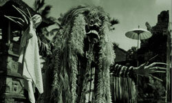 An Indonesian dancer plays the part of the evil witch Rangda in a traditional Barong dance, a representation of the battle between good and evil.