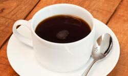 It may give you an energy boost in the morning, but that cup of coffee isn't doing your smile any favors.