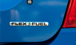 The Flex Fuel logo on a Ford Fusion car parked on the lot at the Serramonte Ford dealership in Colma, Calif.