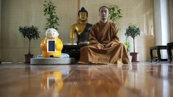 Tiny Robot Monk Joins the Fold at Beijing Buddhist Temple