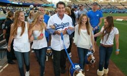 Former Major League Baseball player Steve Garvey (C) and friends at the Bark in the Park at Dodgers' Stadium in Los Angeles.