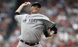 Pitcher Freddy Garcia of the New York Yankees winds up during a game against the Boston Red Sox, on July 7, 2012.