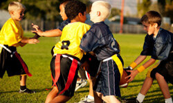 Image Gallery: Football Flag football gives younger athletes the chance to learn how to play football without having to worry about tackles. See more pictures of football.