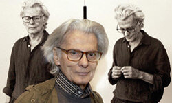 Renowned photographer Richard Avedon poses with a couple of his self-portraits during a 2002 exhibition of his work at New York's Metropolitan Museum of Art.