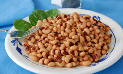 This Southern dish has its base in black-eyed peas, a sign of good luck for the coming new year.