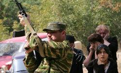 A South Ossetian soldier fires a salute to honor soldiers who were killed in the conflict between Russia and Georgia.