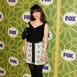 Zooey Deschanel demonstrates a good way to pair a print skirt with a plain top.