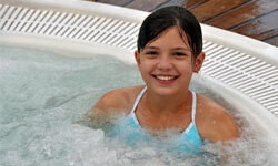Determine whether you want a hot tub for two, or one to accommodate you, your husband and your four kids.