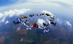 Skydiving Image Gallery Skydivers in formation over Hawaii. See more pictures of skydiving.