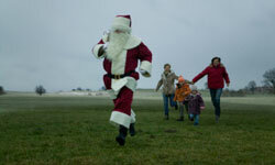 Chasing Santa through a field is a good way to increase your heart rate. See more Christmas pictures.
