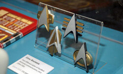 "These replica communicator badges seen at ""Star Trek -- The Exhibition"" in Los Angeles on Oct. 10, 2009, appeared in later TV series."