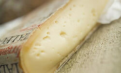 Taleggio may smell like wet grass, but it tastes salty with a hint of fruit and goes great with salads.