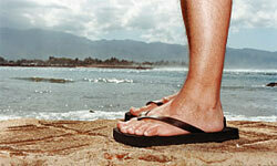 Rubber flip-flops are fine for running around at the pool or beach, but a pair of heavier and more stylish leather slip-ons is worth considering when wearing dressier shorts and pants.