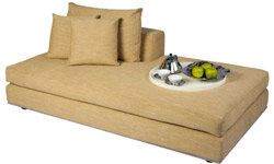 A casual chaise can function as a cozy workspace seat during the day but also serve as a bed for overnight guests.