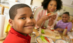Teaching good eating habits and having family meals together may go a long way toward boosting your tween's body image.