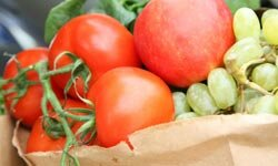 If you have a paper bag, store your tomatoes in it to keep them fresh.
