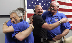 The robot team celebrates in the mission control room the successful Phoenix Mars Lander spacecraft's scheduled landing on the Martian Arctic.