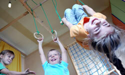 Creating a gym with the kids in mind is a great way to start them exercising early.