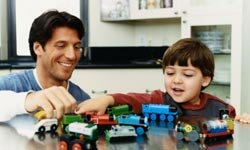 Setting up the train set can bring parents and children together.