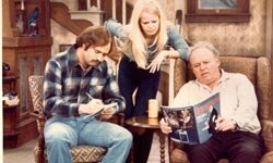 """Archie Bunker (right) pontificates on the latest political disaster to his daughter Gloria and her husband """"Meathead."""""""
