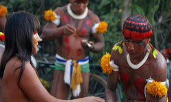 Brazilian Kuikoro Indians share food prior to their Kuarup ceremony in August 2005. Tribes like this one are threatened by encroaching loggers, ranchers and oil prospectors.