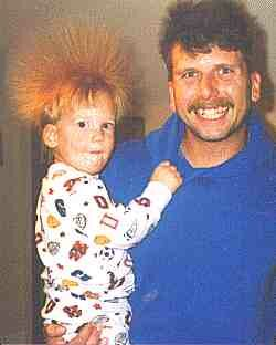 John Zavisa and his son experiencing a close encounter with a Van de Graaff generator!