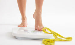 Stepping on the scale frequently can be a warning sign of weight obsession.